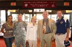Leeann visiting wounded warriors at Walter Reed with former Redskins great, John Riggins
